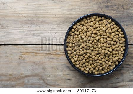 dog food on old wood table, top view