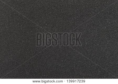 Texture of black sponge background, close up