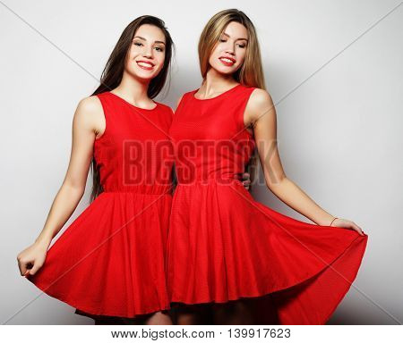 young girls in red dress on white background