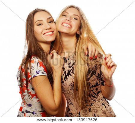 young girls friends in colorful dress on white background