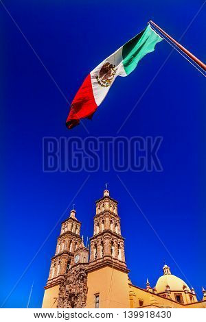 Mexican Flag Parroquia Cathedral Dolores Hidalgo Mexico. Where Father Miguel Hidalgo made his Grito de Dolers starting the 1810 War of Independence in Mexico. Cathedral built in the 1700s.