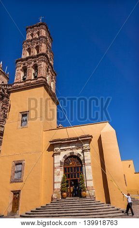 DOLORES HIDALGO, MEXICO -  DECEMBER 29, 2014 Bell Ringer Tower Parroquia Cathedral Dolores Hidalgo Mexico. Where Father Miguel Hidalgo made his Grito de Dolers starting the 1810 War of Independence in Mexico. Cathedral built in the 1700s.