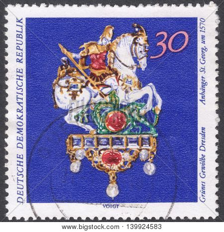 MOSCOW RUSSIA - CIRCA FEBRUARY 2016: a post stamp printed in DDR shows a St.George pendant the series