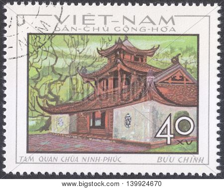 MOSCOW RUSSIA - CIRCA FEBRUARY 2016: a post stamp printed in NORTH VIETNAM shows a example of traditional local architecture the series
