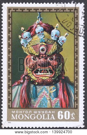 MOSCOW RUSSIA - CIRCA FEBRUARY 2016: a post stamp printed in MONGOLIA shows a traditional Mongol mask the series
