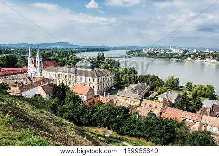 View from Esztergom basilica. Saint Ignatius church and Maria Valeria bridge, Hungary. Travel destination. Cultural heritage. Urban scene. Religious architecture. Danube river.
