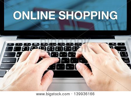 Hand Type On Laptop With Online Shopping Word With Blur Background, Digital Marketing Concept