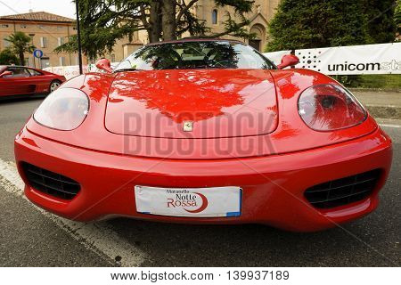 Maranello, Italy - June 18, 2016: Fifth edition of the Maranello red night with Ferrari car on display in the streets of the country