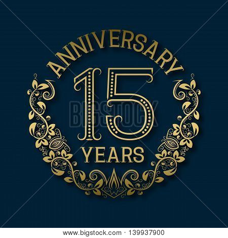 Golden emblem of fifteenth years anniversary. Celebration patterned logotype with shadow on blue.