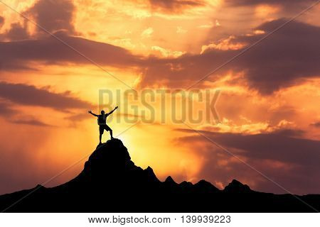 Silhouette Of A Standing Happy Man On The Mountain Peak