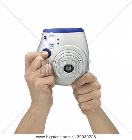 Hand holding and shooting camera on White background. Flashing shot. Clipping path