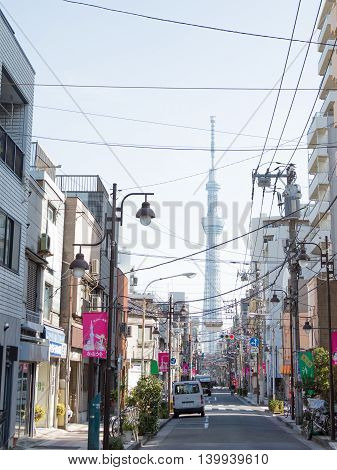 Tokyo - February 4 1015: Low-rise street in Tokyo city center and Tokyo Tower Sky Tree February 4 2015 Tokyo Japan