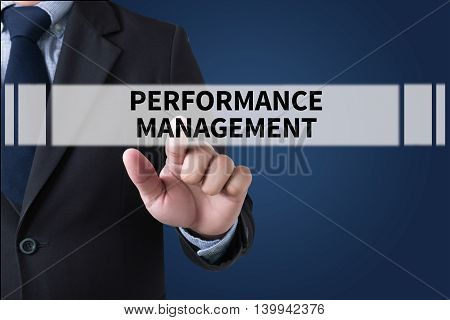poster of PERFORMANCE MANAGEMENT Businessman hands touching on virtual screen and blurred city background