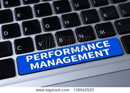 PERFORMANCE MANAGEMENT a message on keyboard computer top