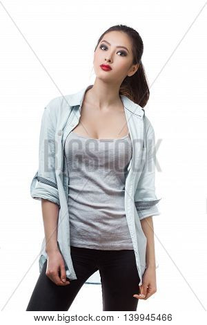 Beautiful young woman posing with serious fashion look in casual. Mixed race Asian Chinese White Caucasian female model.