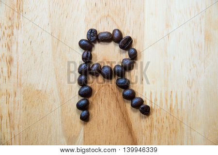 Alphabet 'r' Make From Coffee Bean On Wood Background