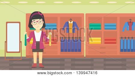 Thoughtful woman holding two neckties and trying to choose the best one. An asian upset female customer choosing necktie at clothing store. Vector flat design illustration. Horizontal layout.