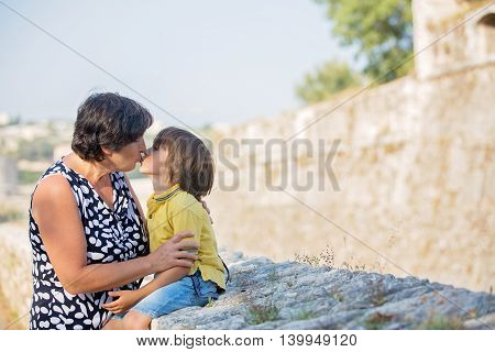 Closeup summer portrait of happy grandmother with grandson outdoors