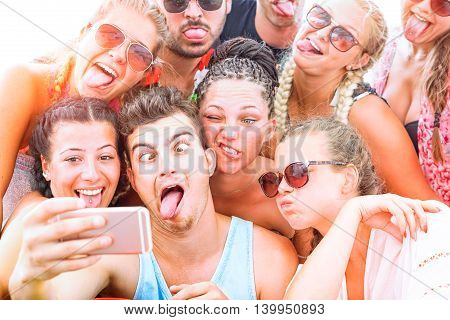 Funny faces friends taking selfie on sunny vacation day - Group of teenagers having fun with mobile photo camera outdoor - Concept of young students summer party together - Soft vintage filter look
