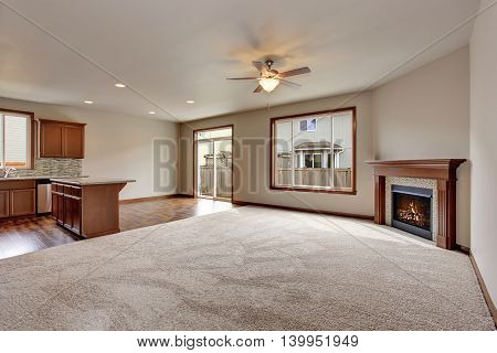 Large Empty Living Room Interior With Carpet Floor And Fireplace.