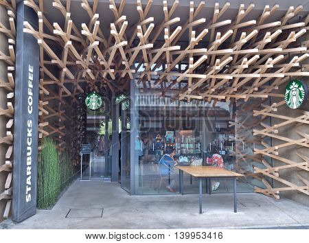FUKUOKA, JAPAN - JULY 16, 2016: Starbucks coffee shop beside road to Dazaifu Tenmangu, a popular Shinto shrine in Fukuoka, Japan. Designed by Kengo Kuma. Starbucks is the world's largest coffee house chain.