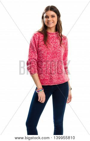 Woman in pink sweater smiling. Dark navy pants. Woolen pullover and stretch trousers. Fashionable spring outfit.