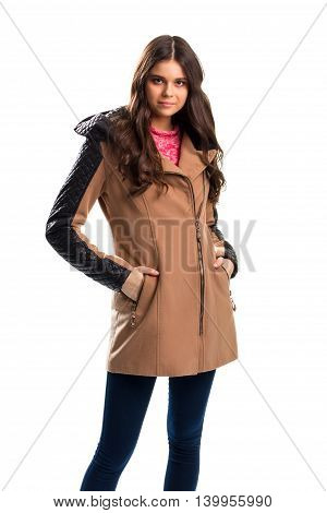Woman in beige coat. Pants of dark navy color. Fleece coat with leather inserts. Outerwear from new boutique.
