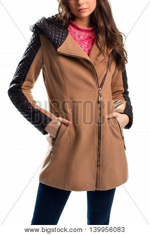 Woman wears beige coat. Short coat with inserts. New design of outerwear. Soft and warm garment.