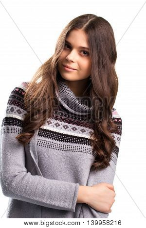 Peaceful face of young woman. Gray sweater with print. Look into my eyes. Composure and kindness.