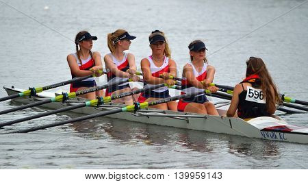 St Neots, Cambridgeshire, England - July 23, 2016: Close up of Female Scullers, Newark Coxed four on the River Ouse at St Neots.