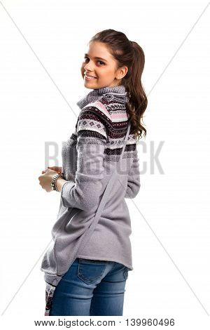 Woman with ponytail is smiling. Colorful print on gray sweatshirt. Share your good mood. Fashion only emphasizes beauty.