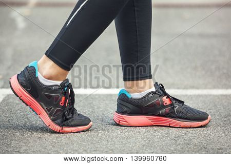 Close Up Of Running Shoes On Road.