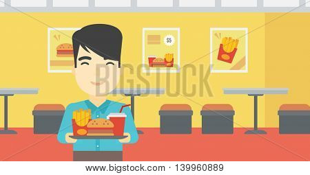 An asian young man holding tray full of junk food on a cafe background. Smiling man in fast food restaurant. Man having lunch in a fast food restaurant. Vector flat design illustration. Horizontal