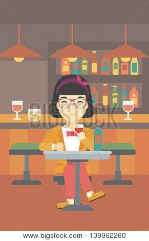 An asian woman sitting at the table with glass and bottle of wine. Woman drinking wine at bar. Woman enjoying a drink at wine bar. Vector flat design illustration. Vertical layout.