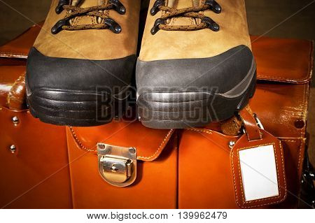 detail of walking boots and travel bag