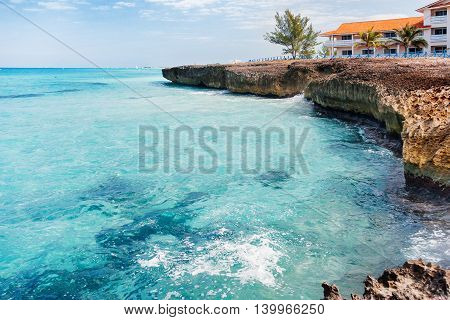 Volcanic tuff coast and azure Caribbean sea. Varadero Cuba.