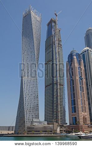 DUBAI, UAE - MAY 14, 2016: view on Cayan Tower in district Marina of Dubai
