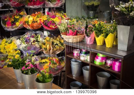 Flower vase arranged on a wooden worktop at flower shop