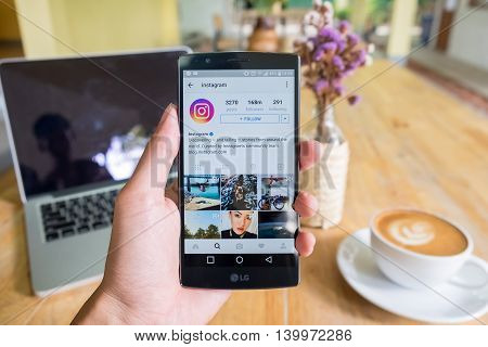 CHIANG MAI THAILAND - JUN 19 2016: A man hand holding lg g4 with instagram application. Instagram is largest and most popular photograph social networking.