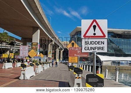 SYDNEY, AUSTRALIA - APRIL, 2016 : Collection of strange signs exhibiting at the Signspotting area, south of Cockle Bay wharf, Darling Harbour in Sydney, Australia on April21, 2016.
