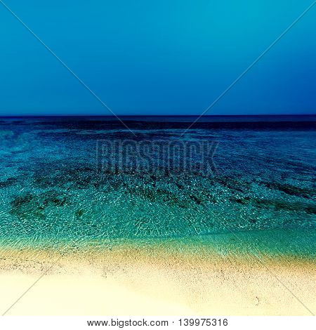 Abstract Sunny day sea paradise background in vintage style. Beautiful sea sand sky in summer time