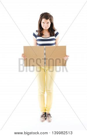Young woman holding an open scrapbook - isolated on white