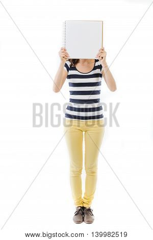 Standing home holding a white card in front of her face - isolated on white