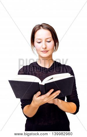 Closeup of a sober woman contemplating and reading a book - isolated on white.