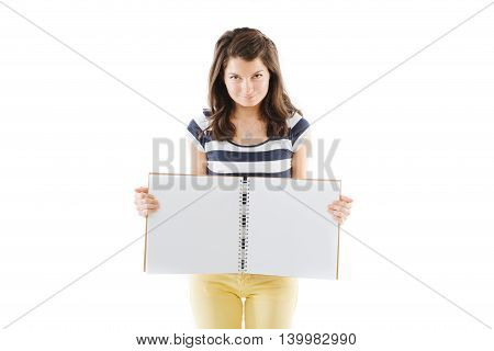 Young standing woman with empty pages scrapbook isolated on white