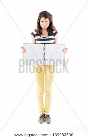 Standing woman holding an empty scrapbook in her hands - isolated on white