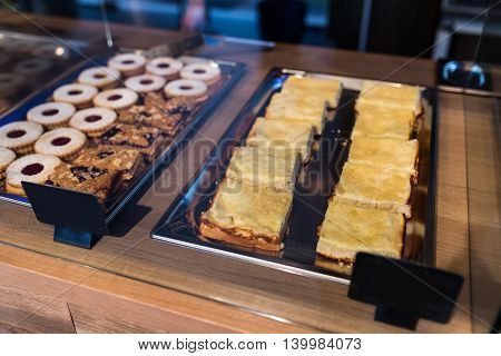 Various desserts on display in bakery window