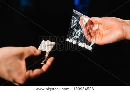 Addicted person exchanging selected type of drugs for money