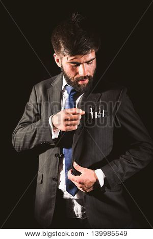 Businessman and drug addict choosing a syringe from his pocket