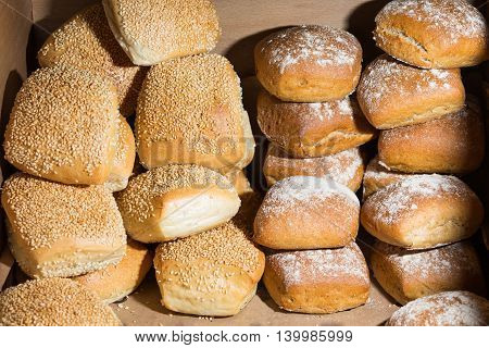 Buns with sesame and flour in a breadbasket